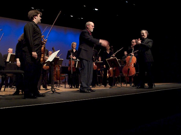 Charles Wuorinen with the orchestra, after performance of Synaxis